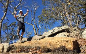 Peggy, a Backyard Hiker, jumping from a rock.